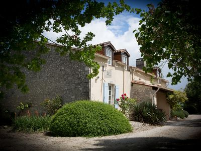Photo for Rural French charm meets English cool - gîte supérieur for 8 with private pool