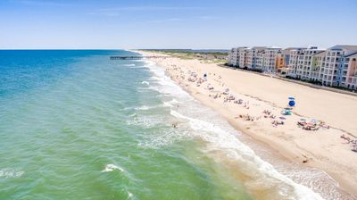Photo for Spacious beach condo w/ beautiful views of beach and bay and a pool table!