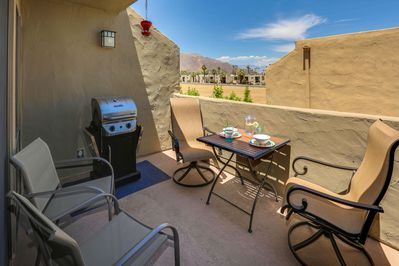 Private balcony with dining table and stainless steel gas BBQ