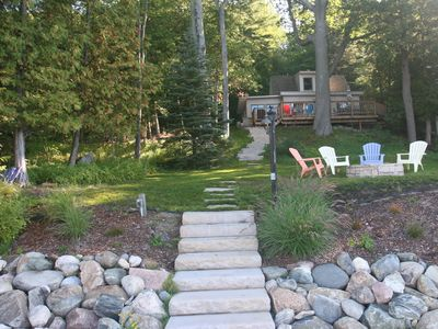 Photo for Cozy Knotty Pine Cottage On  Lake Charlevoix  with boat lift and mooring