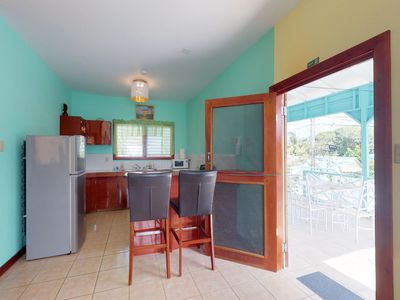 Photo for NEW LISTING! Breezy, in-town villa w/ shaded deck & WiFi - steps to the beach!