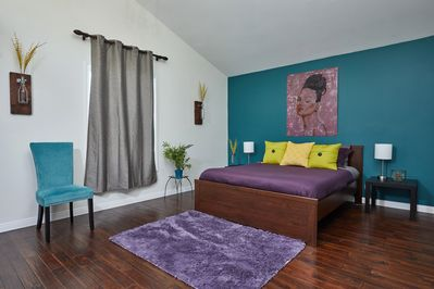 Spacious master bedroom with top of the line bedding & his & hers closets.