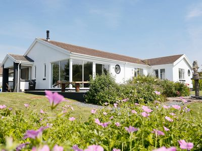 Photo for Stunning Sea Views set in Tranquil Gardens. Art Filled, Modern Property. Lamorna