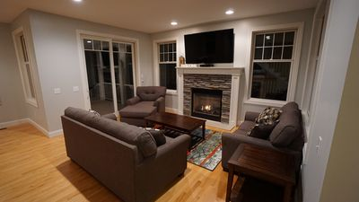 """Main level living room, 65"""" TV with Charter HD cable."""