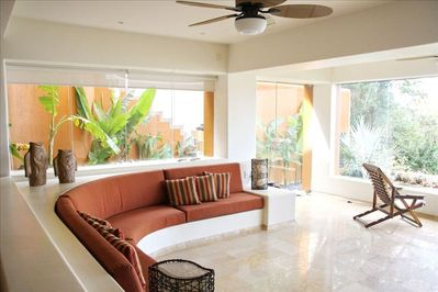 HUGE LIVING ROOM AND PARTIAL GARDEN VIEW PLUS STAIRS TO INFINITY POOL !!
