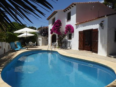 Photo for 3 bed villa with private underlit pool, air con & wifi.  Walk to beach.