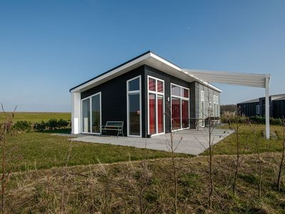 Photo for Modern chalet with a panoramic view near the Oosterschelde