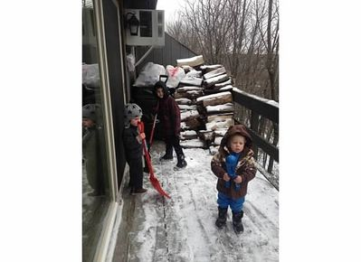 The boys are shoveling off the deck so we can get access to our firewood!