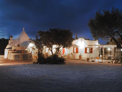 Photo for beautifully restored Trulli with large roof terrace, in the Valle d' Itria