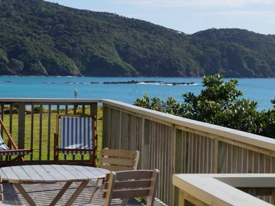 Photo for Beachfront Bland Bay tranquility with stunning sea views from sun-drenched deck