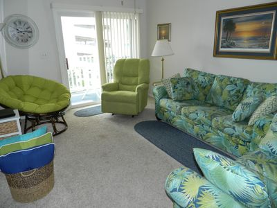 Comfortable living space with sleeper sofa, love seat, recliner and chair -- roomy for the whole family.