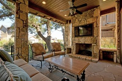 Porch - The ideal outdoor sitting area with all the comforts of the inside like a TV and fireplace.
