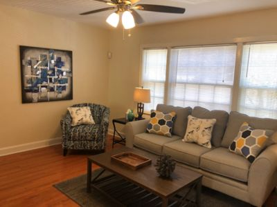 Photo for Cozy little yellow jewel box home away from home