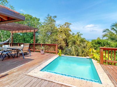 Photo for Home w/ nature & ocean views, private pool, deck, hammocks - walk to the beach!