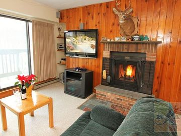 Across from Snowshed Base lodge with sport center and shuttle service