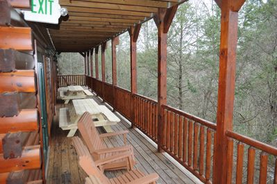 Two new 8' picnic tables for outdoor dining + lots of rocking chairs on 3 levels