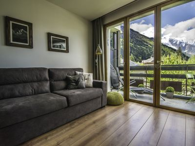 Photo for Charming apartment in the center of Chamonix, magnificent view of the montages