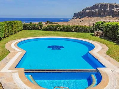 Photo for 2 bedroom villa with great sea views, close to Lindos and Pefkos villages and beaches 10 minutes drive away. lovely swimming pool and lawns and elevated terrace for dining.
