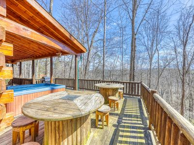 Photo for Cozy cabin nestled in the woods w/ private hot tub, firepit & foosball!