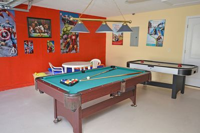 Garage converted to games room with pool table and air hockey