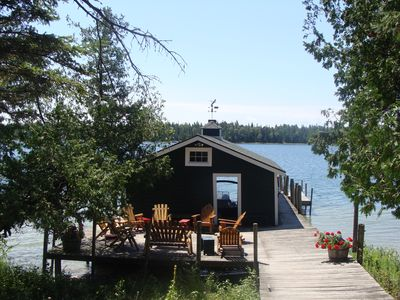 Boathouse features 20x28 fully furnished entertaining deck, hot shower & frig.