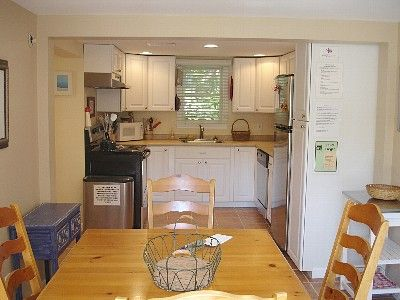 Renovated 2010 with tile floors, SS appliances, seats 6 and opens to a large deck