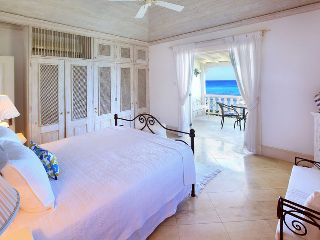 Beautiful 4 bedroom coral stone villa located right on the stunning Reeds Bay