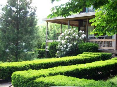 Manicured lawns and wraparound decks with lots of seating for sunning and fun!