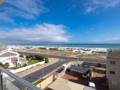 Photo for Lovely oceanfront condo with free wifi, wind-free balcony, and sea views