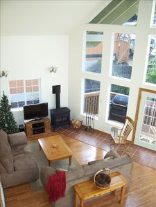 Relax & unwind in the rustic,cozy living room with gas fireplace &flat screen TV