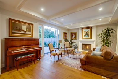 Living Room with fireplace and Steinway piano