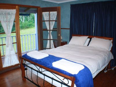 Lie in the comfortable queen bed with a view.