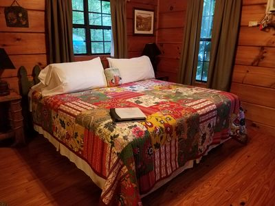 Photo for Charming pet-friendly cabin with hot tub for two: Your perfect mountain retreat!