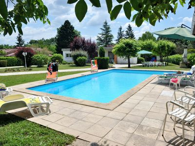 Photo for Holiday villa with wifi and swimming pool on large park.