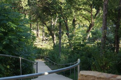 The walk down to the Guadalupe River from the The Village at Gruene Complex.