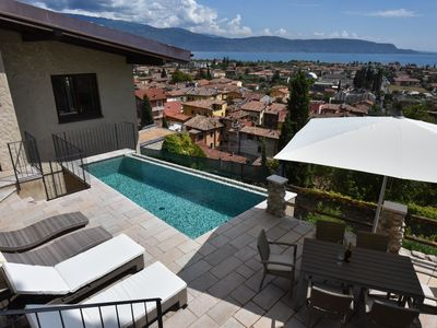 Photo for Villa above the roofs of Maderno with pool, sauna and sensational views !!