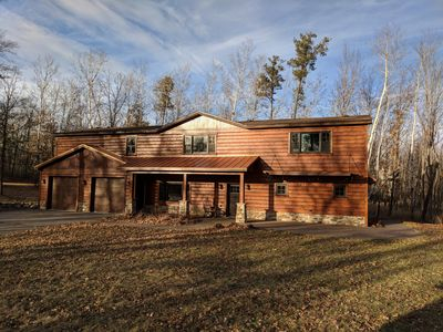 Photo for Large lake front cabin, has 2 kitchens and comes with a pontoon! Bring the fam!!