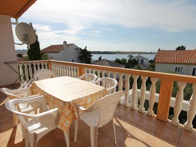 Photo for Three bedroom apartment with terrace and sea view Novalja (Pag) (A-9339-c)