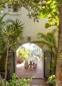 Enter the spectacular Mystic Ridge Villa.  From the driveway down stone steps you enter through two stately wrought iron gates.