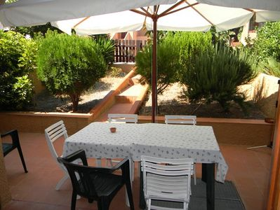 Photo for Alghero, villa on two levels in the bay of Porto Conte three bedrooms