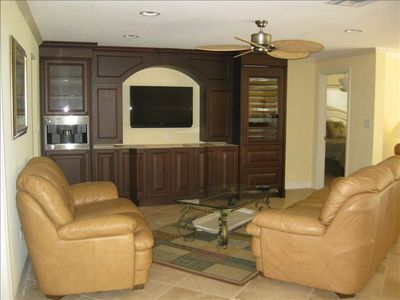 "Family room with new entertainment center, 42"" flat screen TV, wine cooler"