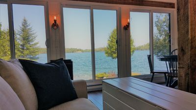 Photo for Pristine waters of Pemichangan lake - luxury Cape-Cod style waterfront cottage!