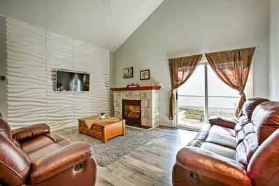Unwind in front of the flat-screen Smart TV, or by the gas fireplace.