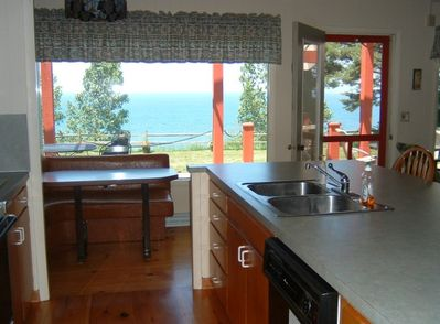 kitchen has a stove, ref. dishwasher, large counter space