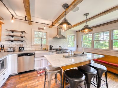 Photo for Expansive home w/ fire pit, wet bar and screened in porch