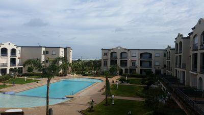 Photo for Relaxing apartment in a charming pool residence. Beach 5mn walk