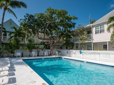 Photo for Lovely condo w/ a private patio, shared pool & perfectly walkable location!
