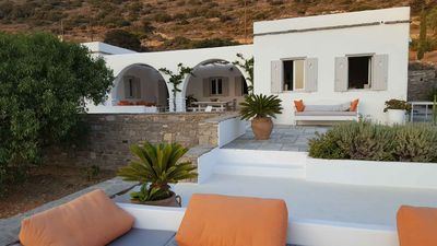 Photo for Cycladic house among olive trees and Aegean sea, beautiful sea view