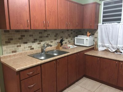 The kitchen is big and comfortable with many typical appliances