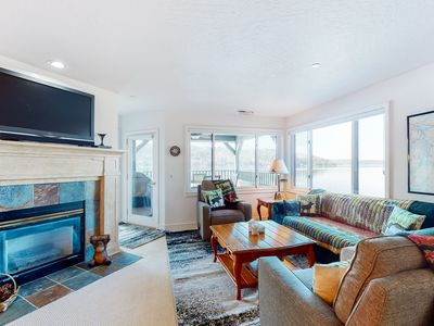 NEW LISTING! Lakefront condo w/ stunning views, balcony, & fireplace!